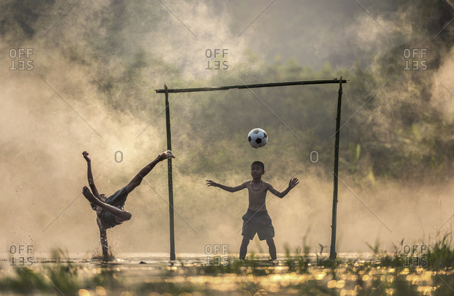 Boy kicking a soccer ball