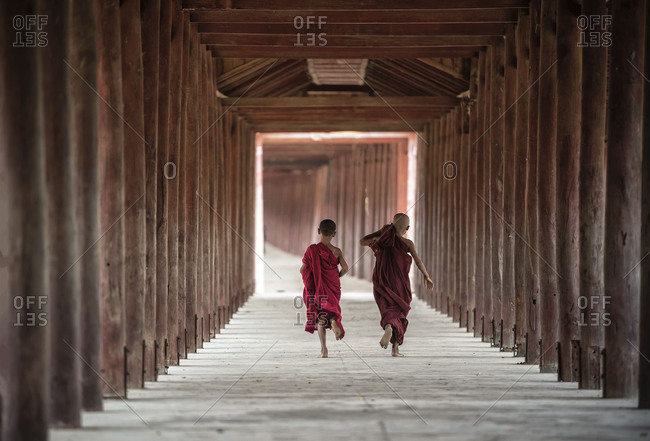 Back side of Buddhist novice are walking in pagoda ,myanmar