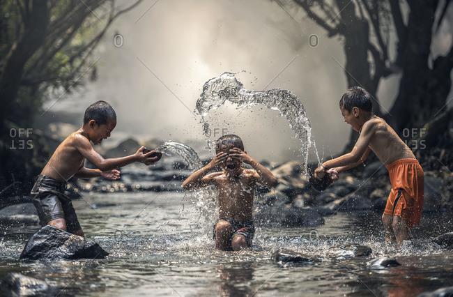 Three boy joyful with splashing