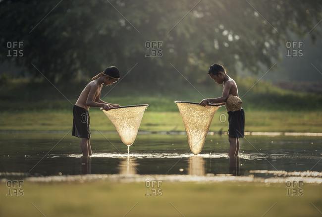 Asia boys fishing in the lake