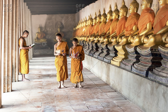 Thai Novices at temple in Ayutthaya Historical Park, Thailand