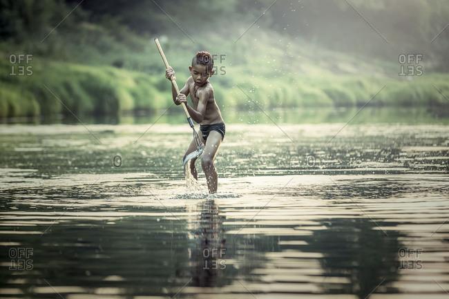 Asian boys fishing at the river