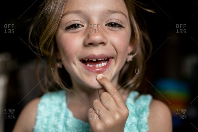 Portrait of girl showing gap tooth