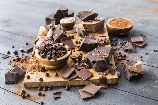 Various chocolate pieces on cutting board