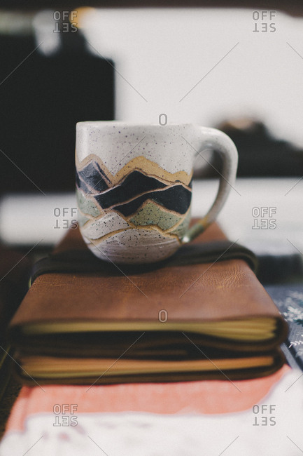 Mug on top of books