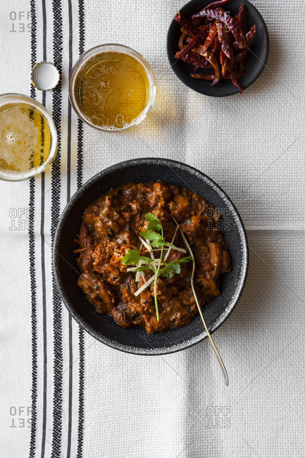 Indian Curry with red peppers on a white table cloth