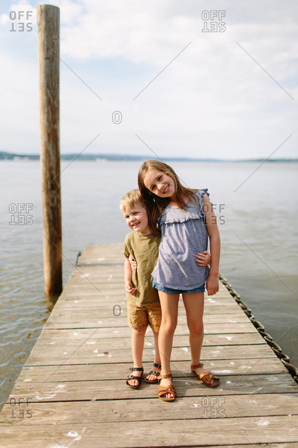 Portrait of two young siblings standing on dock