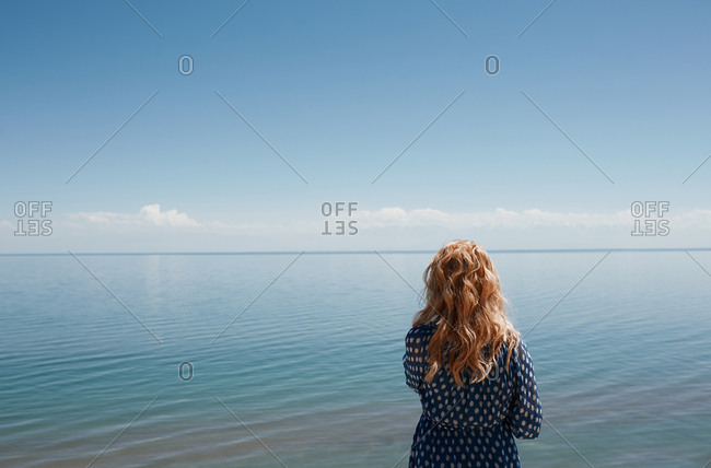 Blond woman looking at the sea