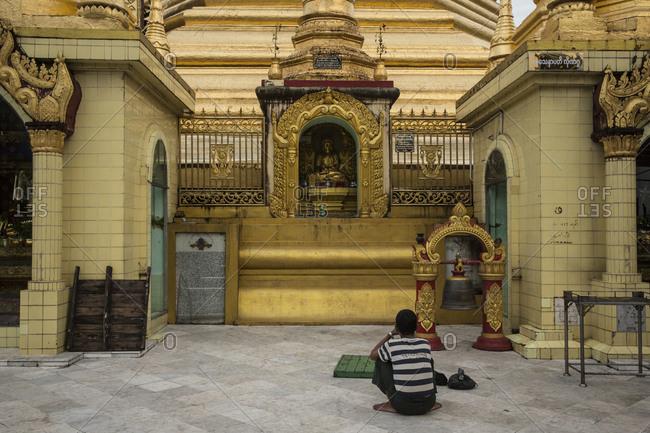 Yangon, Myanmar - 18 September 2016: Praying at Sule Pagoda, Yangon, Myanmar