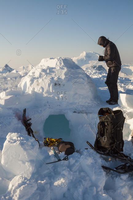 Man camping in igloo in Garibaldi Provincial Park
