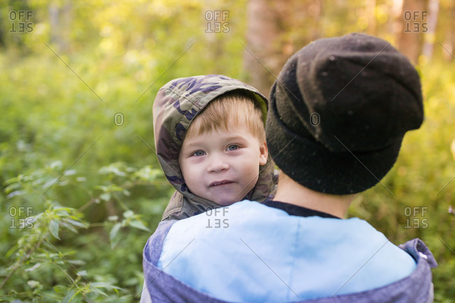 Mother and son walking in autumnal forest, Moscow, Russia