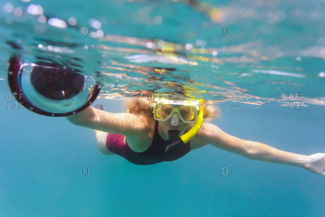 Front View Of Woman Snorkeling With Underwater Camera Permuteran Bali Indonesia Stock Photo
