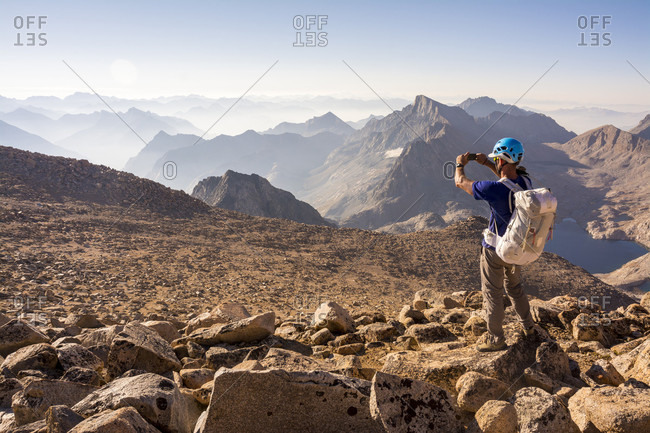 Man hiking up Mount Fiske along the 8.5 mile Evolution Traverse, John Muir Wilderness, Kings Canyon National Park, Bishop, California