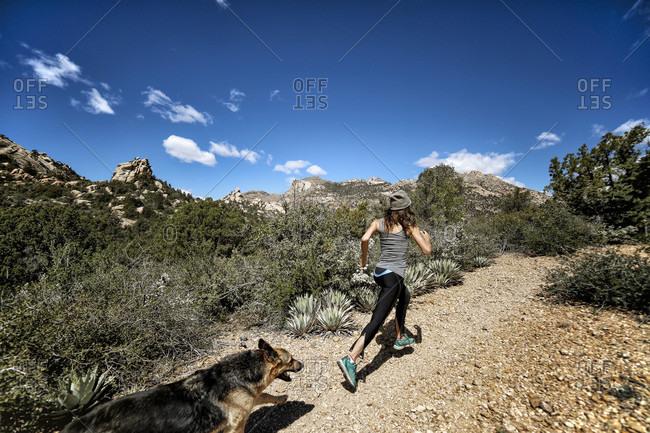 Athletic Woman Ultra Marathon Runner in the High Desert Mountains