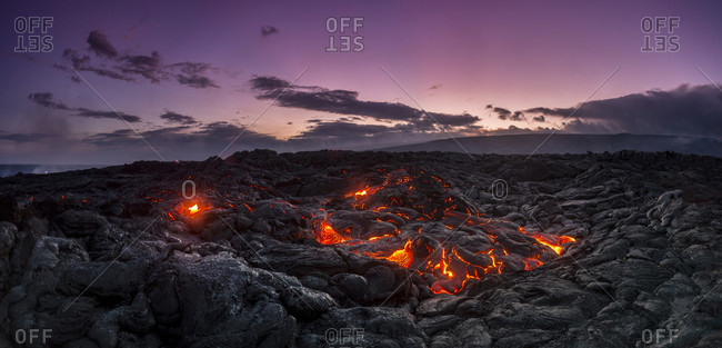Fresh Lava break, during evening twilight at the Kalapana Lava flow, on the big island of Hawaii.