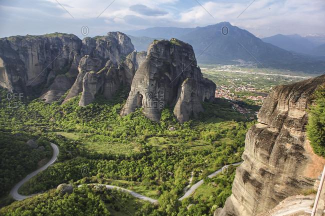 Road winding through stone towers and ancient monasteries of Kalambaka in Meteora Region, Greece