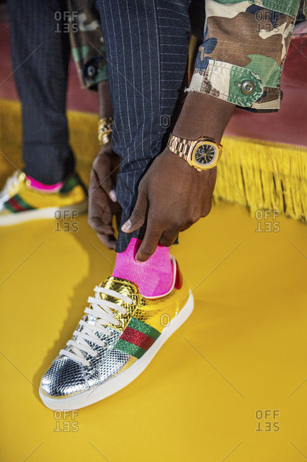New York, USA 2017: Man wearing colorful shiny sneakers