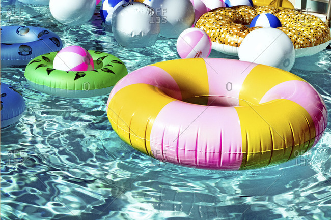 Palm Springs, California 2017: Colorful inflatable balls and rings in a pool
