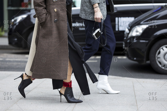 London, England 2017: Two stylish women walking on city sidewalk
