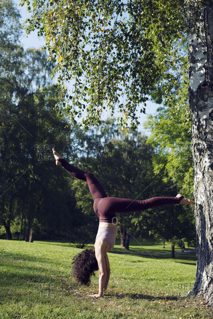 Oslo, Norway 2016: Woman doing yoga in a park in Oslo, Norway