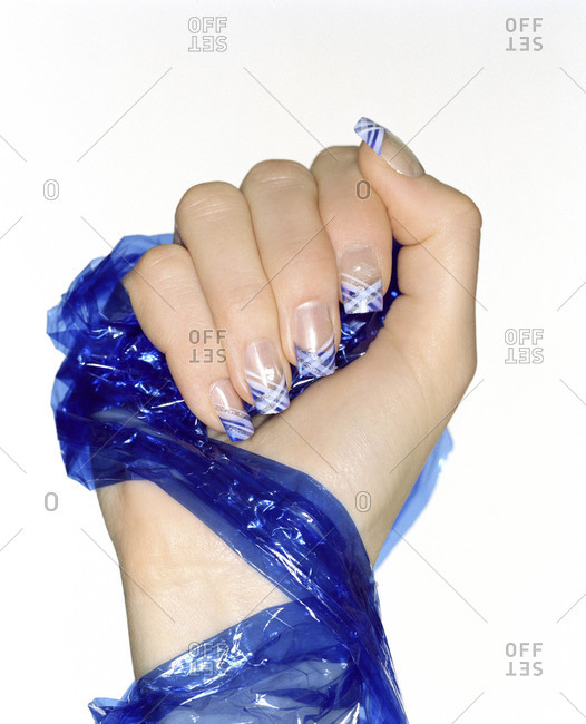 Hand of woman wrapped in blue plastic wrap
