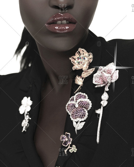 London, England 2012: Close up of woman wearing several broaches