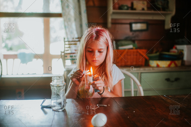 Young girl burning paper