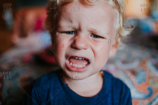 Close up of a toddler with an upset expression