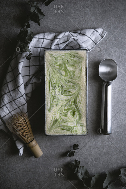 Overhead view of matcha green tea ice cream on kitchen counter