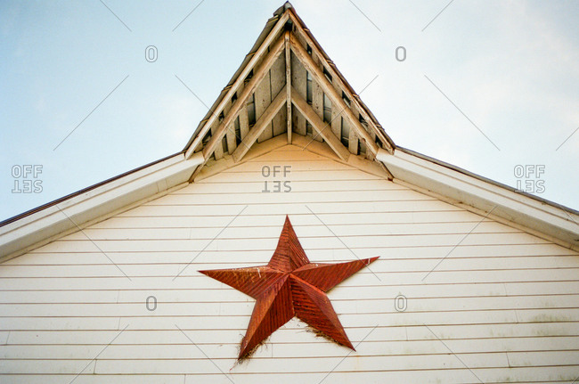 Rustic old farm building with a star decoration