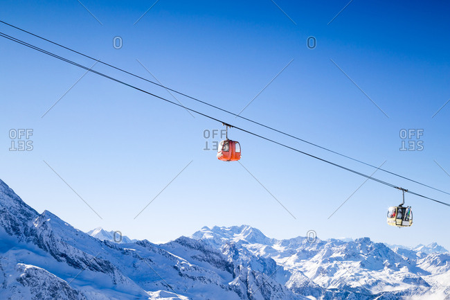 Cable cars carry skiers in the French Alps