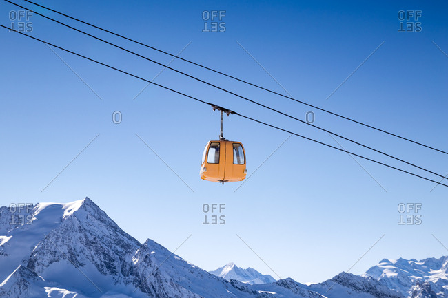 A ski gondola above the French Alps