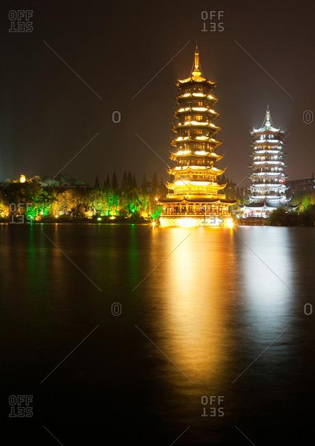 Gold and silver pagodas illuminated at night, Guilin, China