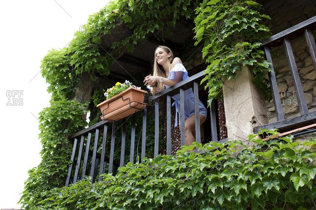 Woman on balcony in village