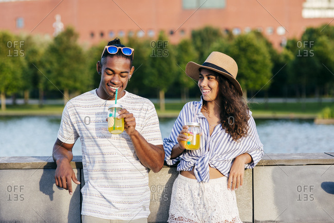 Couple with refreshing drinks