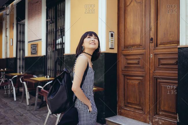 Lovely girl walking on street