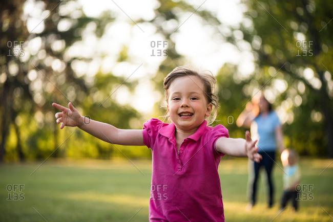 Running carefree girl kid looking at camera