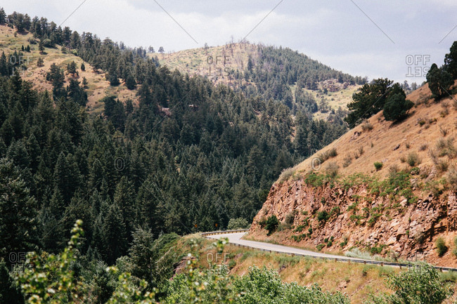 Winding road on mountainside in Colorado