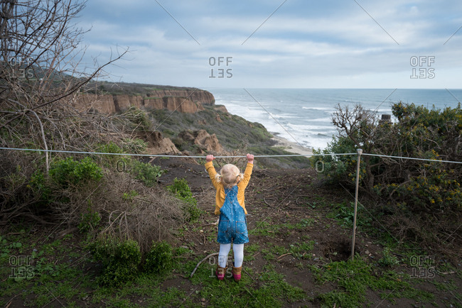 Toddler girl at coastal overlook