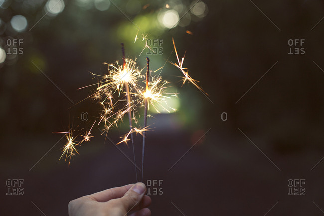 Lit sparklers in close up