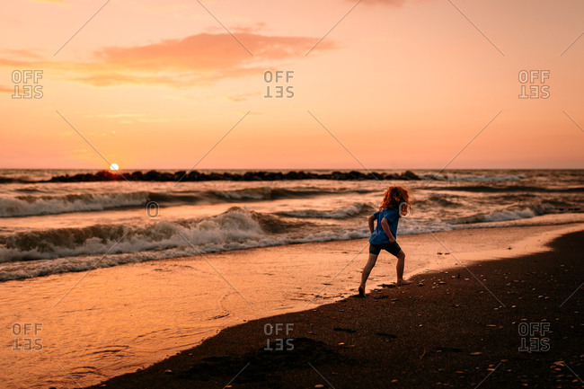 Child on beach during sunset
