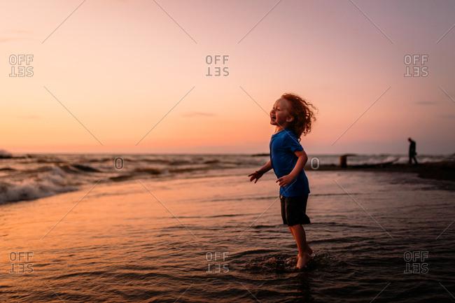 Child on beach during sunset
