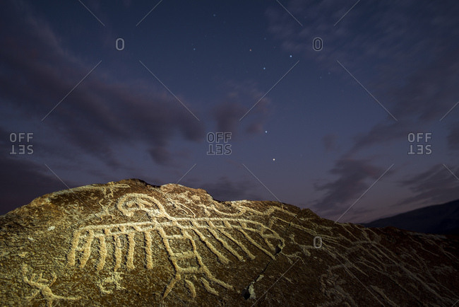 Toro Muerto petroglyphs at night under the stars and the Southern Cross.