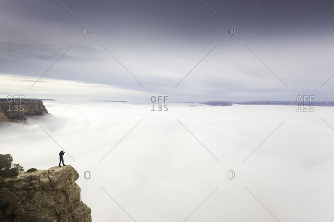 Grand Canyon National Park, Arizona, USA - December 11, 2014: A photographer taking a picture of fog in the Grand Canyon.