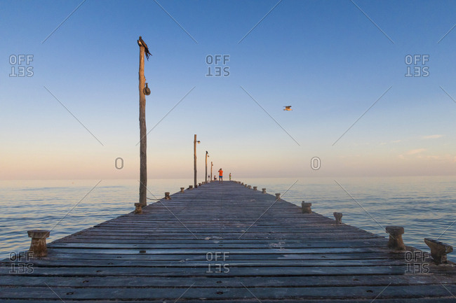 A pier on the Gulf of Mexico at twilight in Isa Holbox.