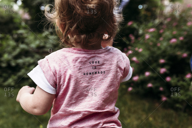 Back view of toddler wearing t-shirt