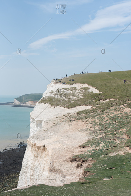 People on white chalk cliffs in Sussex, England