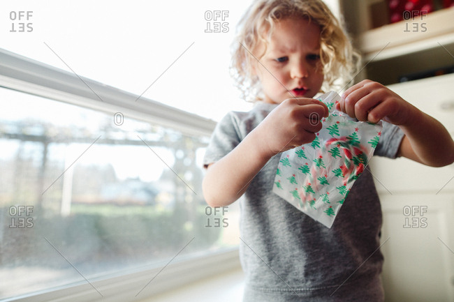 Boy with bag with candy canes