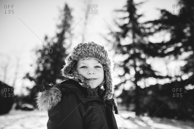 Smiling boy in fur lined hat