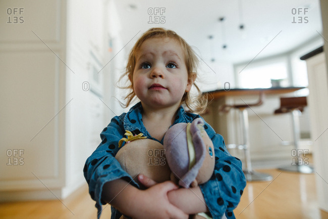 Toddler girl holding her doll